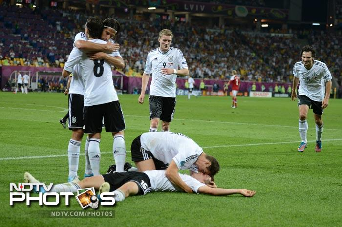 Goals from Lukas Podolski and Lars Bender gave Germany their third win in the tournament as they remained unbeaten in their group after defeating Denmark 2-1. (AFP Photo)