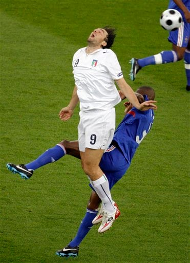 Italy's Luca Toni and France's Eric Abidal vie for the ball during the group C match between France and Italy in Zurich, Switzerland on June 17, 2008.