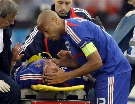 France's Franck Ribery is carried off the pitch, as fellow team member Thierry Henry looks at him, during the group C match between France and Italy in Zurich, Switzerland on June 17, 2008.