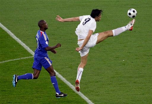Italy's Luca Toni goes for the ball moments before being fouled by France's Eric Abidal to give away a penalty during the group C match between France and Italy in Zurich, Switzerland on June 17, 2008.