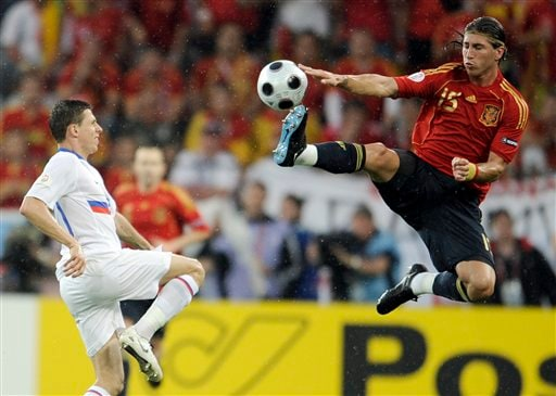 Spain's Sergio Ramos, right, reaches for the ball as Russia's Igor Semshov looks on during the group D match between Spain and Russia in Innsbruck, Austria.