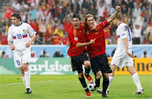Spain's Fernando Torres, foreground right, and David Villa, center, celebrate Villa scoring the opening goal during the group D match between Spain and Russia in Innsbruck, Austria.
