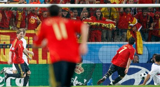Spains's David Villa, right, scores the opening goal during the group D match between Spain and Russia in Innsbruck, Austria.