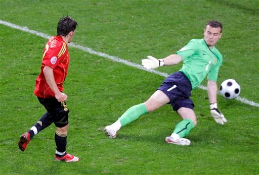 Spain's David Villa, left, scores his second goal past Russia's goalkeeper Igor Akinfeev during the group D match between Spain and Russia in Innsbruck, Austria.
