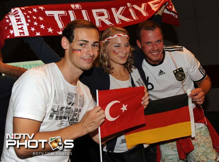 Matches are not always fought. They can be great occasions to come together as is shown here by Turkish and German supporters.