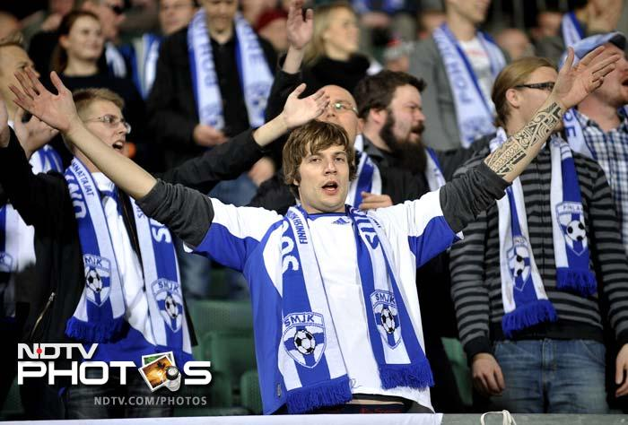 Finnish fans celebrate their team against Hungary after an Euro 2012 Group E qualifying match in Budapest.