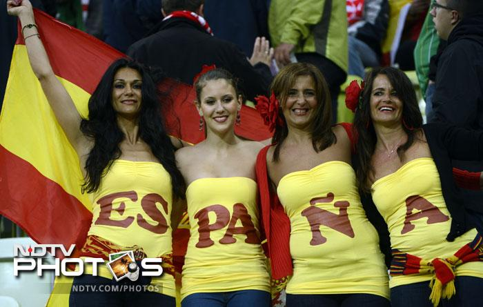 Four goals were scored in the Spain-Ireland encounter with Torres netting a brace. Four Spanish fans are seen here reveling in the Spanish glory. (AFP PHOTO / PIERRE-PHILIPPE MARCOU)