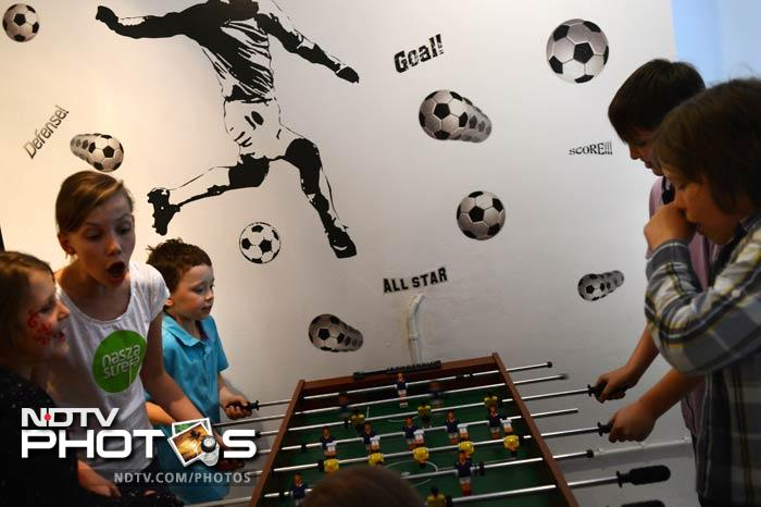 Children play football table during a children party in Warsaw ahead of the start of the Euro 2012 football championships. (AFP Photo)