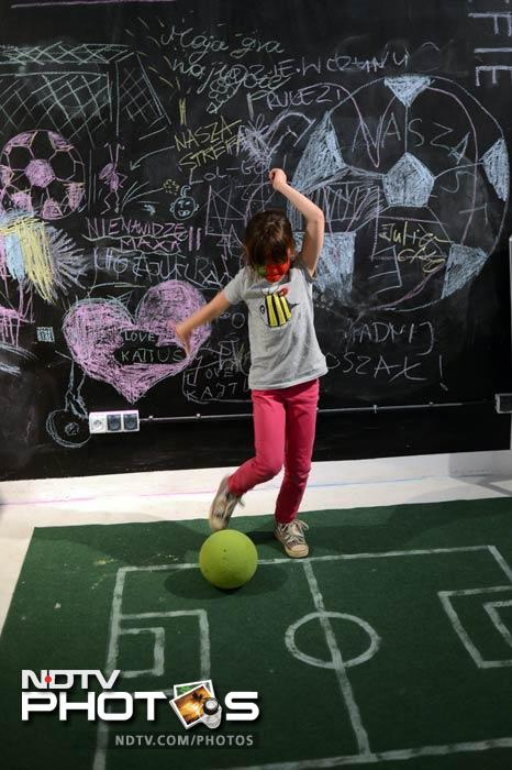 A girl with the Portuguese flag painted on her face plays football during a children party in Warsaw ahead of the start of the Euro 2012 football championships. (AFP Photo)