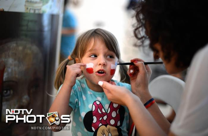 The biggest football carnival of the year is about to start and hosts Poland and Ukraine are all decked up for it. A woman paints the Polish flag on the face of a little girl in Warsaw ahead of the start of the Euro 2012 Championships. (AFP Photo)