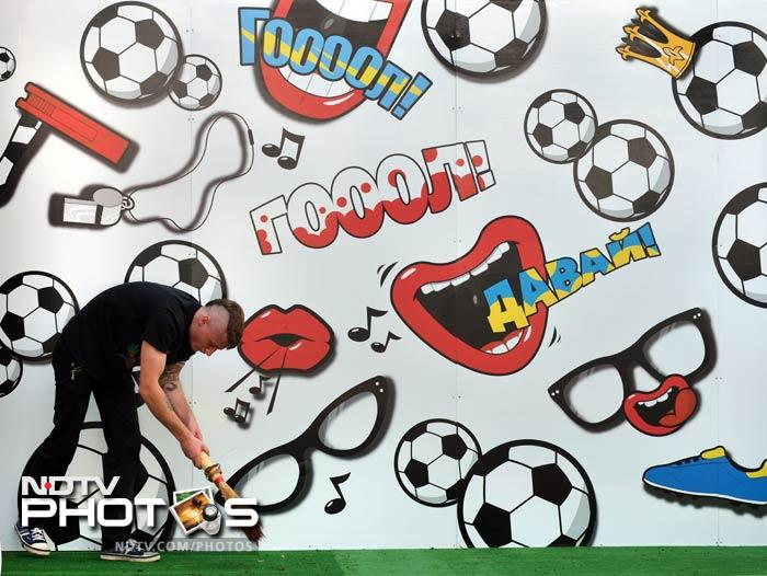 A man sweeps the floor at his cafe in the Euro 2012 fanzone in central Kiev. The Euro 2012 football Championships will take place in Poland and Ukraine from June 8 to July 1. (AFP Photo)