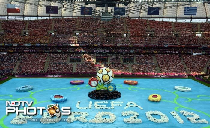Euro 2012 kicked-off with a short opening ceremony at Poland's National Stadium on Friday. (AFP PHOTO/GABRIEL BOUYS)