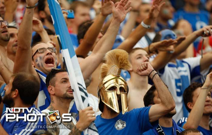 Supporters of Greece's national team cheer prior to the Euro 2012 soccer championship Group A match between Poland and Greece. (AP Photo/Matt Dunham)
