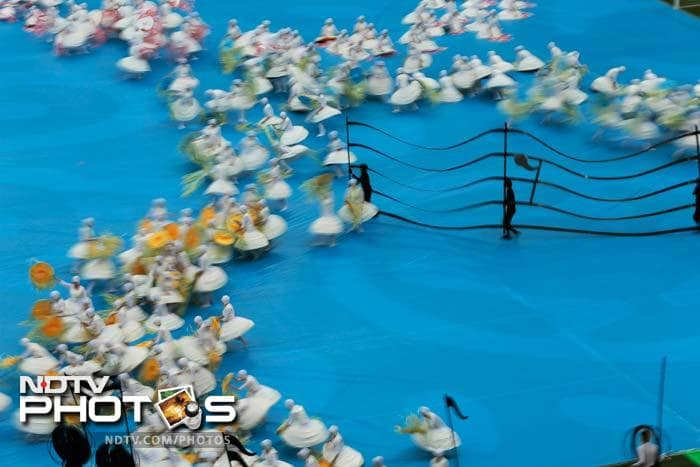 Chopin's music morphed seamlessly into a specially-composed arrangement by Italian producer-DJ Karmatronic, as the performers massed in formation around inflatable miniatures of the eight stadium venues.