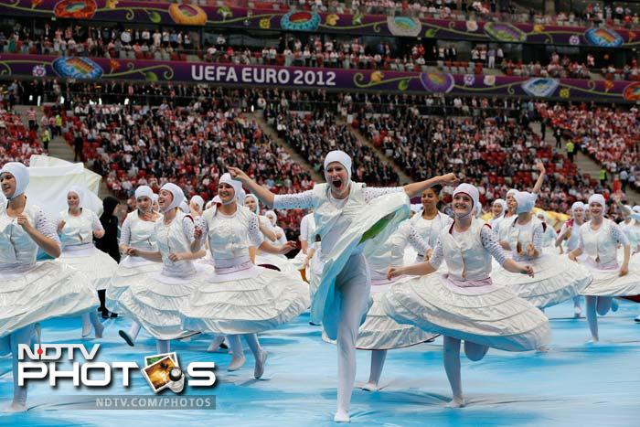 Artists perform during the Euro 2012 soccer championship opening ceremony in Warsaw. (AP Photo/Gero Breloer)