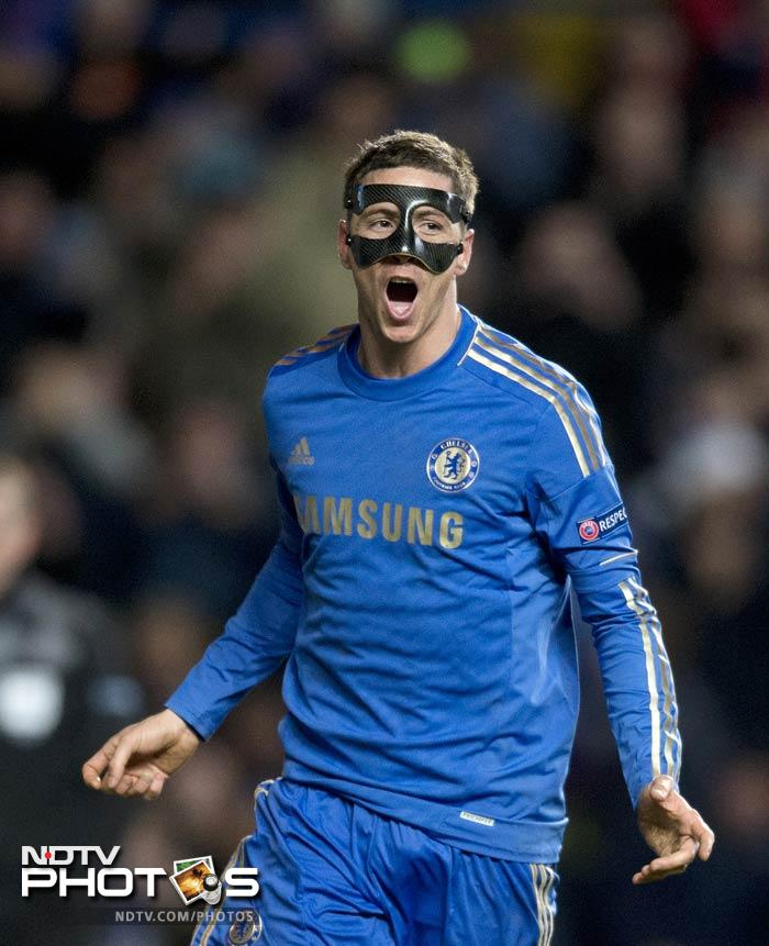Spanish striker Fernando Torres - sporting a face mask to protect a broken nose - scored twice as Chelsea beat Rubin Kazan 3-1 in the first leg of their quarterfinal tie.