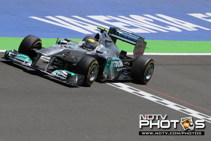 Mercedes' German driver Nico Rosberg also made no progress from his qualifying position but maintained his 7th spot. Team-mate Michael Schumacher however, had a disastrous outing, falling to 17th after having started from the 8th spot. (AFP Photo)