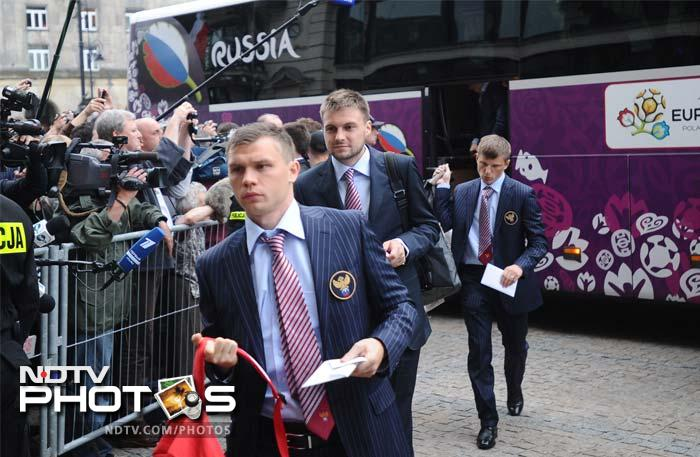 The Russian team was one of the first to arrive, seen here getting off the team bus to enter the hotel. (AP Photo/Czarek Sokolowski)