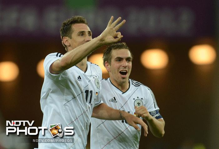 Miroslav Klose piled on the misery for Greece to give Germany a two goal advantage and a sure chance at securing a position in the last four. (AFP Photo)