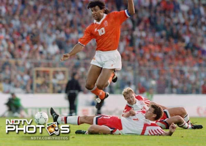 <b>Henrik Larsen (Denmark)(1992):</b> Larsen (on the ground, behind) provided the offensive spark in a defense dominated team. He went on to score three goals at Euro 92, including both goals in the crucial 2-2 semi-final draw against the Netherlands. He also converted his kick in the ensuing penalty shootout, and played full time when he and the Danish national team won the final against Germany.
