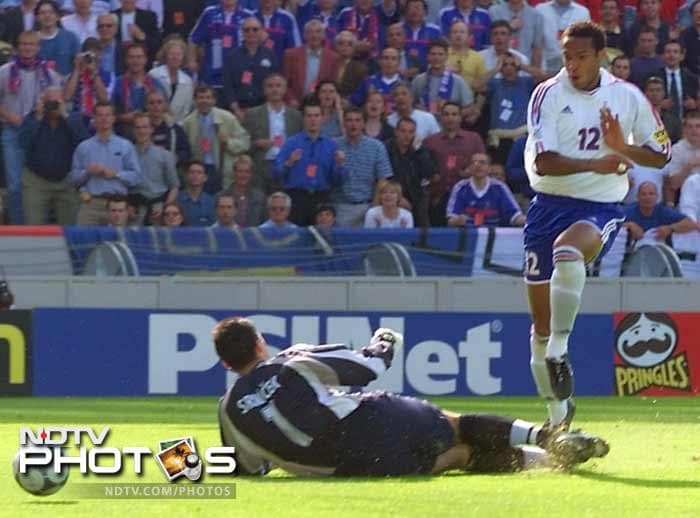 <b>Thierry Henry (France)(2000):</b> If Zindane was the creative influence in the midfield then Thierry Henry (in white) was the striking force in France's team that won the 2000 championship. He scored three goals in the tournament and was his country's top scorer. His equaliser in the semi-final against Portugal was instrumental in earning France a place in the final. Henry was voted man-of-the-match in three games including the final against Italy which France won in extra time.