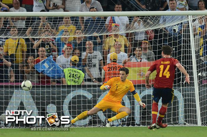 It was that man again, Xabi Alonso who sounded the death knell for the French when his spot kick found the target in the dying stages of the game. Spain managing to double their goal advantage and end France's hopes of a semi final berth. (AFP Photo)