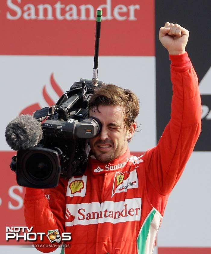 It was an impressive race for Fernando Alonzo as he finished third from a grid position of 10. Here, the Ferrari-man tries to take over as the cameraman of a broadcasting channel.