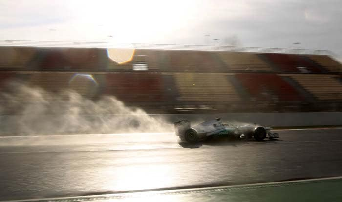 Hamilton, gettting to grips with his new Mercedes drive, clocked 1 minute 41.614 seconds in cold, rainy conditions at the Catalunya Circuit near Barcelona.