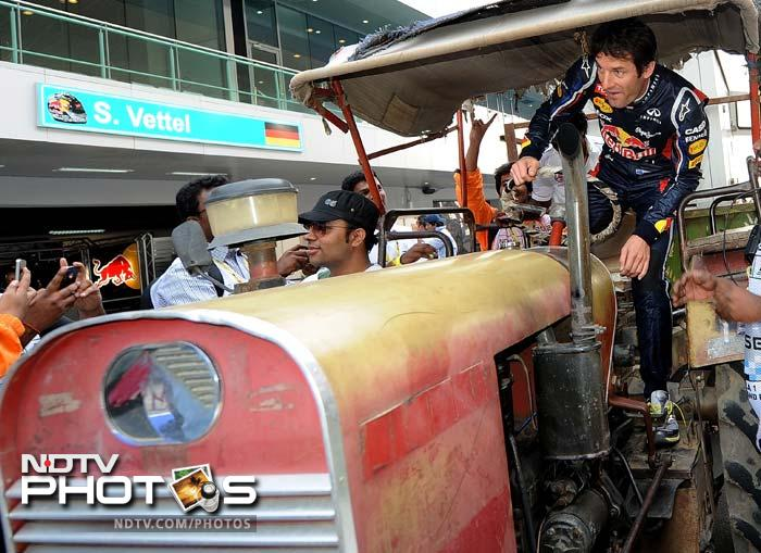 Webber obliges camera persons as he puts pedal to the metal here. (AFP Photo)