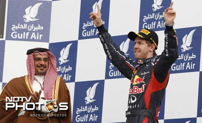 Sebastian Vettel was back at doing what he does best - winning. He converted his pole position to a comprehensive win at Bahrain to claim his first trophy of the 2012 season. A look at him and other racers. (AFP and AP images)