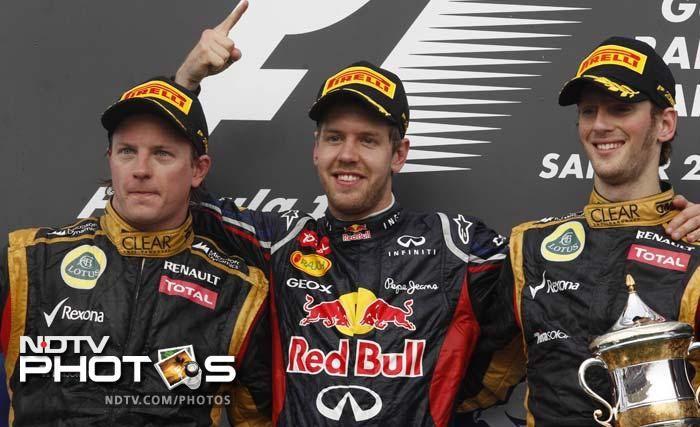 Vettel was joined on the podium by Lotus F1 drivers Romain Grosjean and Kimi Raikkonen (left) who finished third and second respectively.