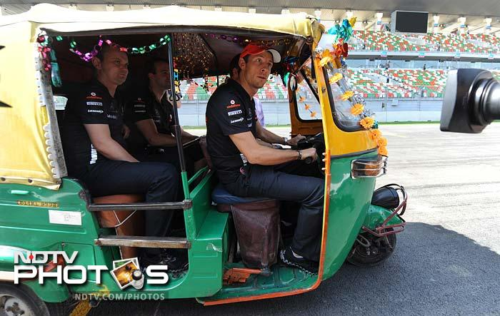 There of course are the real stars of F1 here too. Jenson Button of McLaren takes the drivers seat of, well, it is there for all to see. Wonder what lap-time he recorded on it.?. (AFP image)