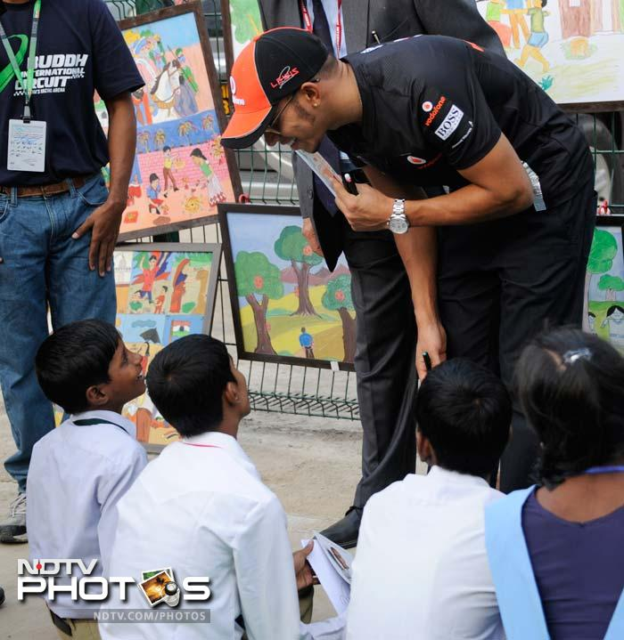 McLaren's Lewis Hamilton was also present and can be seen chatting with some of the children here. (AFP image)