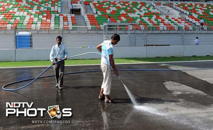And the 'crew' at the track also work hard to get everything in place. The smallest of details are extremely important in preparing for a F1 race. (AFP image)