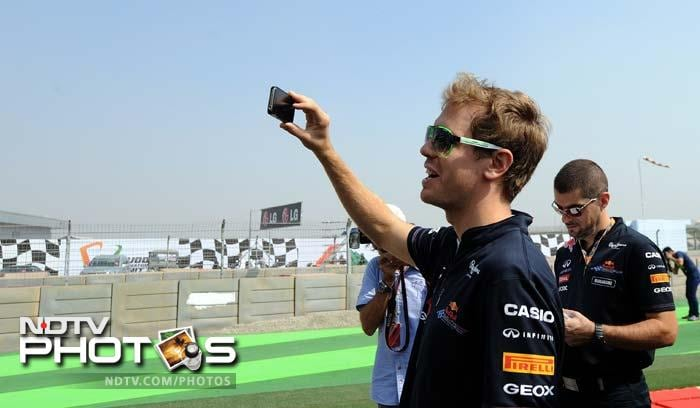 He is currently the most followed and clicked F1 driver but defending champion Sebastian Vettel decides here to be behind the camera than be in front of one. (AFP image)