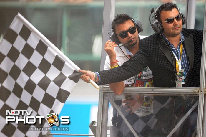 Gagan Narang waved the chequered flag during the Formula One Indian Grand Prix. (AFP Photo)