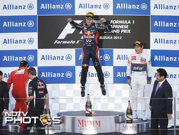 The 25-year-old German, who won in Singapore only two weeks ago, became the first man this year to score back-to-back wins as he slashed Fernando Alonso's championship lead to just four points with five races left.