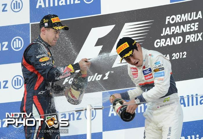 """""""Woo-hoo! Yes baby, Yes baby... unbelievable!"""" screamed Vettel over his team radio on his slowing-down lap, after taking a big step forward in his pursuit of a third consecutive world title.<br><br> He came home comfortably clear of Alonso's Ferrari team-mate Felipe Massa with local hero Kamui Kobayashi third for Sauber, a result that made him only the third Japanese driver to score a podium finish in Formula One."""