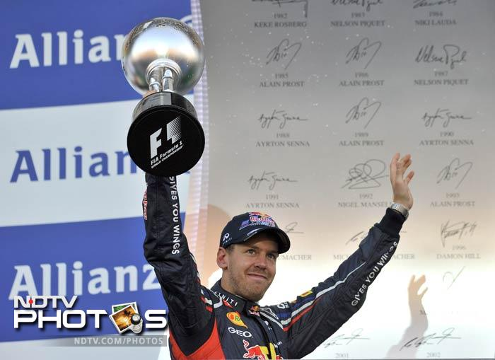 It was literally a cruise for Sebastian Vettel at Suzuka as he drove home to a 24th career win. Fernando Alonso, though, suffered a shock first lap exit and the difference between the two now, is just 4 points. With the title race heating up, this could be the turning point of the season. (All AFP Photos and text)