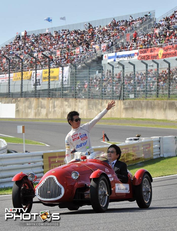 Local favourite, Kamui Kobayashi, waves to the massive crowd support from his classic car before the race began.