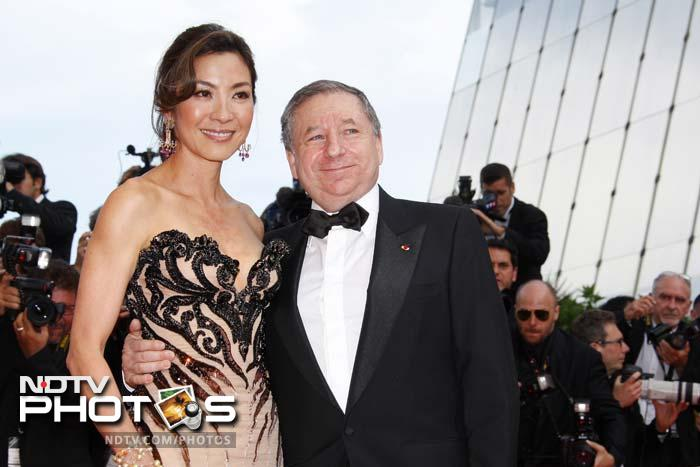 """<b>Michelle Yeoh:</b> This one was too good to be left out even though she's not engaged to a F1 driver. The former Miss Malaysia and Bond girl, who appeared in Tomorrow Never Dies with Pierce Brosnan, is the partner of FIA President Jean Todt. She has been voted the greatest action heroine of all time by film critic website Rotten Tomatoes in 2008. In 2009, she was listed by People magazine - the only Asian actress - as one of the """"35 All-Time Screen Beauties""""."""