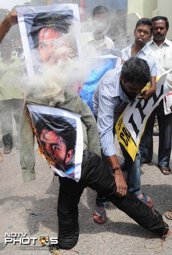 Protestors burn an effigy with posters of Indian cricketer Shanthakumaran Sreesanth at a protest against spot fixing during the Indian Premier League in Bangalore.