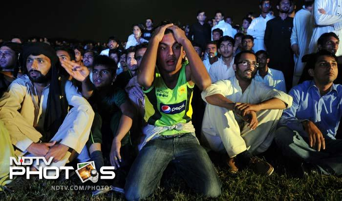 A Pakistani fan reacts after his team lost Imran Nazir early. The opener has been in good form but lost out against India.