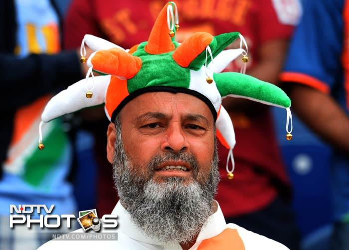 England and Wales may be hosting the tournament but the teams from the sub-continent, especially, have no problems in getting loud cheers.<br><br>An Indian fan during his team's match against South Africa at Cardiff.