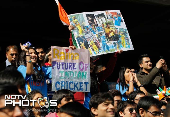 This is an image of fans cheering India during the successful warm-up match against Sri Lanka where Virat Kohli and Dinesh Karthik played superb knocks.