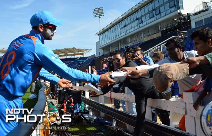 Kohli is seen here obliging fans. The maverick batsman may have had certain incidents with fans which he would want to forget (remember series in Australia?).<br><br>He however lets his bat do the talking and it further strengthens the bond which he shares with his fans.