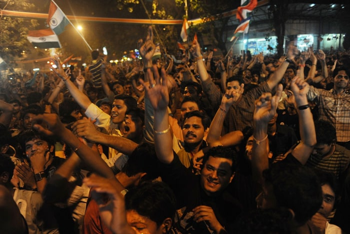 <b>Mumbai: </b>Indian fans celebrate India's victory in semi-final match against Pakistan. (PTI Photo)