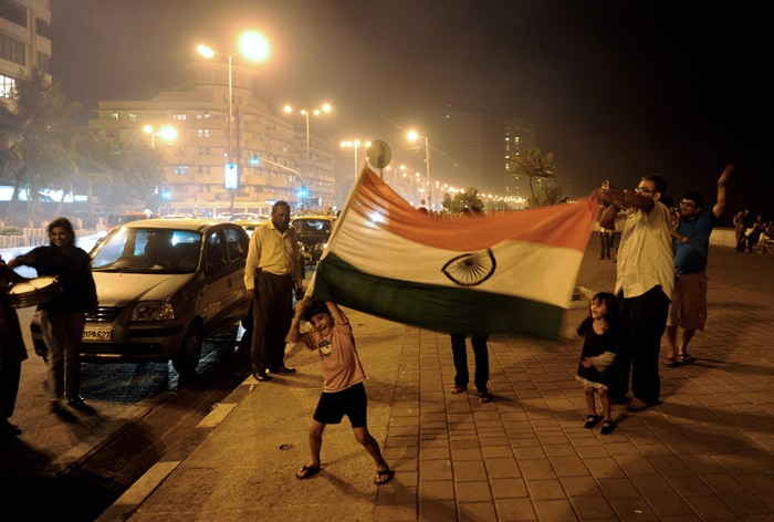 <b>Mumbai</b>An Indian child holds a national flag as he celebrates India's victory in a semi final. (AFP Photo)