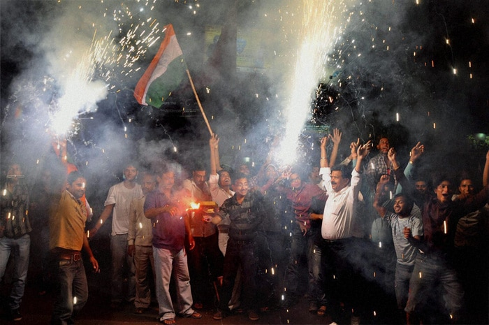 <b>Jharkhand: </b>Indian fans celebrate the team's victory over Pakistan in the Cricket World Cup semi final match. (PTI Photo)
