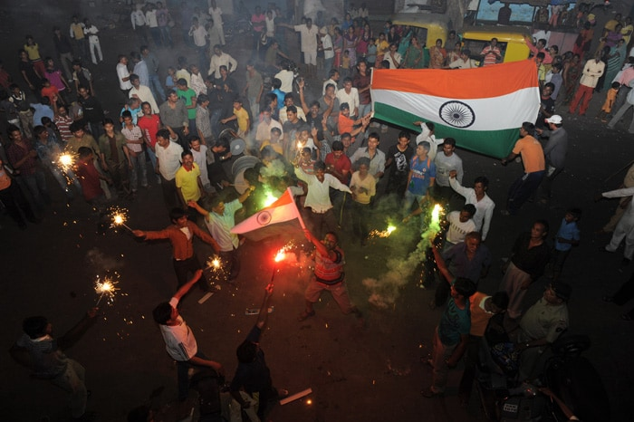 <b>Ahmedabad: </b>Indian cricket fans celebrate with fireworks. (AFP Photo)